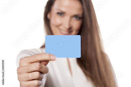 Fotografia  young business woman hold in her hand blank credit card