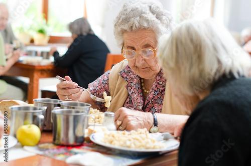Valokuva  senior woman eating
