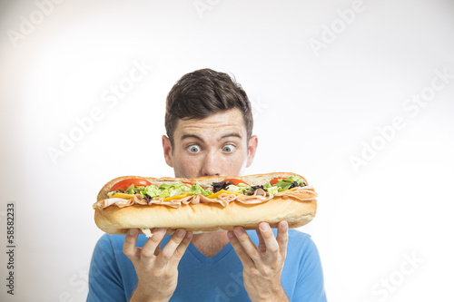 Photo  man eating sandwich