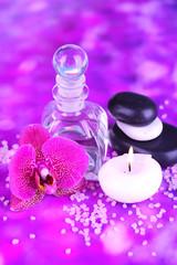 Obraz na płótnie Canvas Spa oil with orchid on purple background