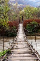Fototapeta Mosty Autumn scene with a bridge and leaves