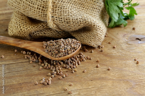 Canvas Prints Coffee beans Dry buckwheat groats on a wooden table