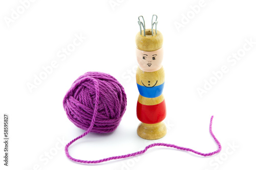 ball of yarn and a knitting spool buy this stock photo and explore