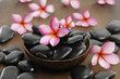 Set of frangipani with pile of stones in bowl