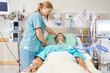 canvas print picture - Nurse Adjusting Patient's Pillow