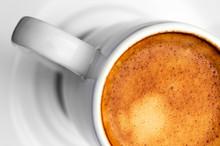 Macro Close Up Studio Shot Of A Half Cup Of Espresso Coffee