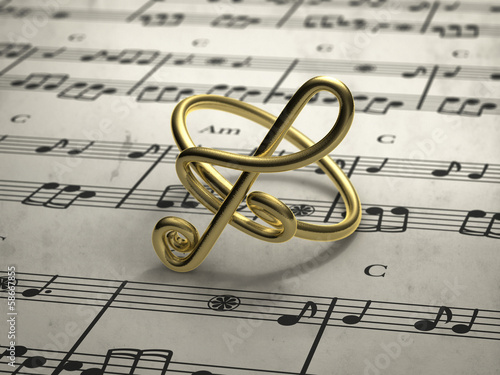 Fotografía  musical note ring with score in background