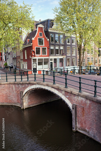 Photo  Canal Bridge and Houses in Amsterdam