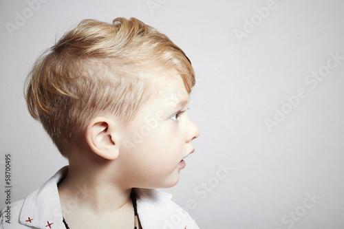 fashionable handsome little boy. stylish haircut. fashion child