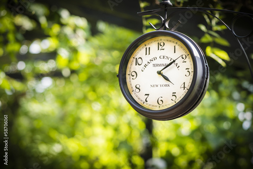 Clock Grand Central on green blured background horizontal. Wallpaper Mural