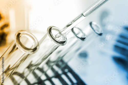 Fotografia  pipette and test tube on coloured background
