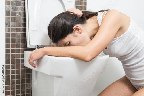 Fotografie, Obraz  Woman vomiting into the toilet bowl