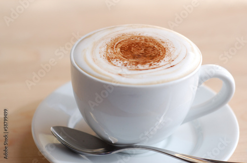 Fotografie, Obraz  Creamy cappuccino on wooden surface with copy space.