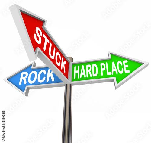 Fotografie, Obraz  Stuck Between Rock Hard Place 3 Arrow Road Signs