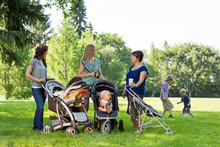 Happy Mothers With Baby Strollers