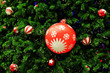 Decorated green christmas tree with ball