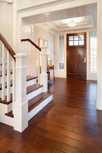 Entryway And Stairs In Luxury Home