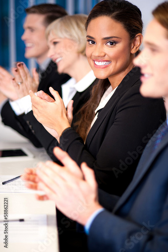 Photo Business team of four applauding