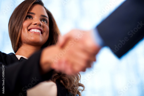 A handshake between business people Poster