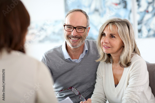 Senior couple meeting financial adviser for investment Canvas Print