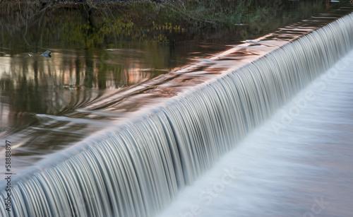 Valokuva  motion blurred river weir