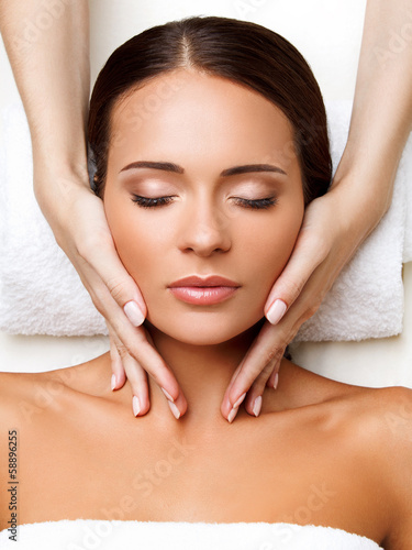 Poster  Face Massage. Close-up of a Young Woman Getting Spa Treatment.