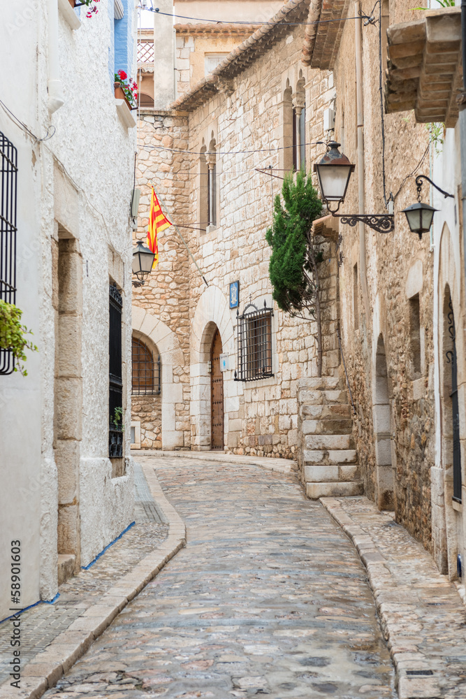 Fototapety, obrazy: Medieval street in Sitges old town, Spain