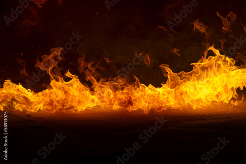 Door stickers Fire / Flame Blazing flames on black background