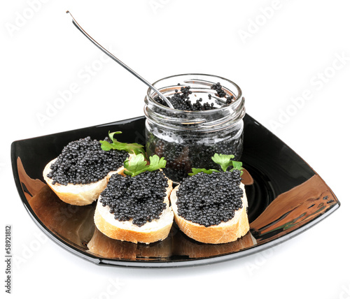 Sandwiches with black caviar on plate isolated