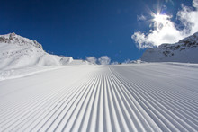 Fresh Snow Groomer Tracks On A...