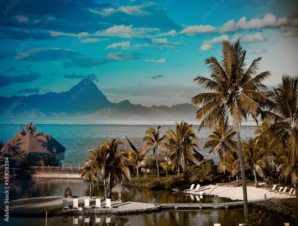 Fototapeta A sunset over ocean and   mountain. Polynesia. Tahiti,