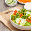 Green salad with tomato, cucumber and carrots