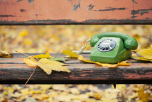 Green Vintage Phone On Bench In Autumn Park
