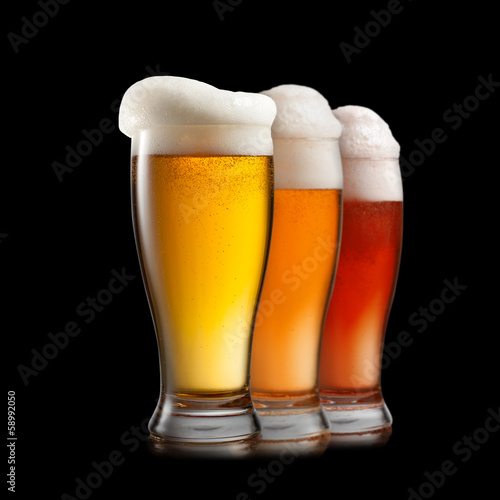 Foto op Canvas Alcohol Different beer in glasses isolated on white background
