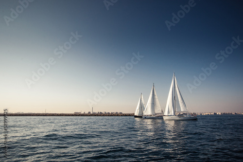 Obraz na plátně Sailing ship yachts with white sails