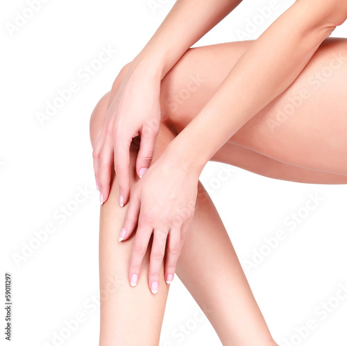 Recess Fitting Manicure Female legs and hands, white background