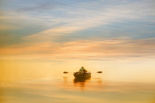 Lonely Man Boating In The Dawn