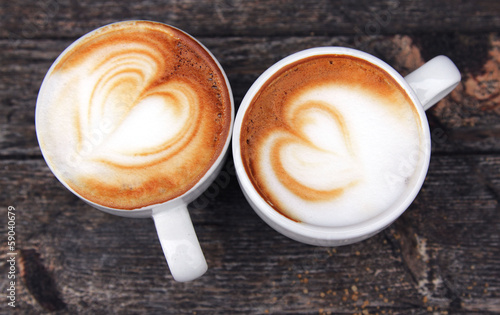 Foto two cups of coffee cappuccino