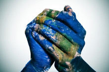 The World In Your Hands (Earth Map Furnished By NASA)