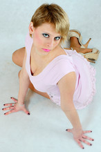 Blonde Girl Sitting In A Pink ...