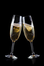 Champagne Glasses On Black Backgorund