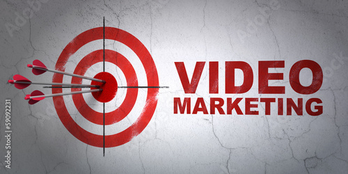 Photo  Business concept: target and Video Marketing on wall background