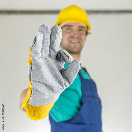 Fotografia  Construction worker showing ok sign