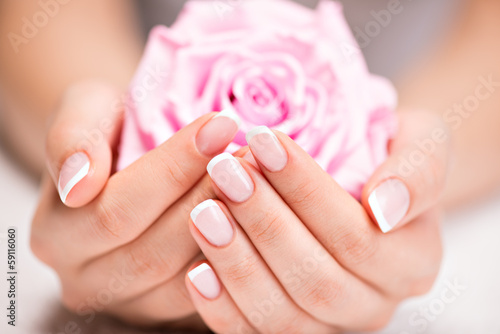 Poster Manicure Beautiful woman's nails with french manicure and rose