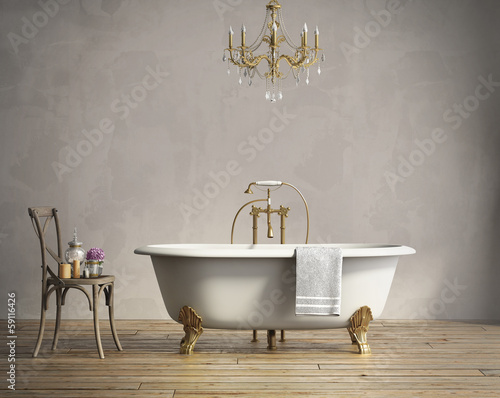 Valokuva  Classic bathtub with chandellier and aged wood floor