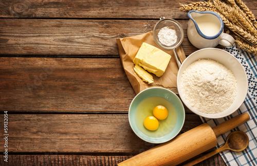 Fotografie, Obraz  Dough recipe ingredients on vintage rural wood kitchen table