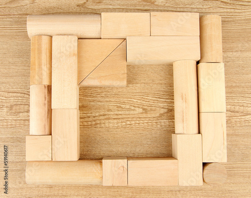 Fototapeta Wooden toy blocks on wooden background obraz na płótnie
