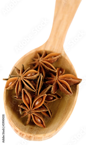Foto op Canvas Kruiden 2 Star anise in wooden spoon, isolated on white