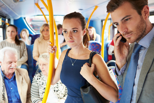 Passengers Standing On Busy Commuter Bus - 59148401