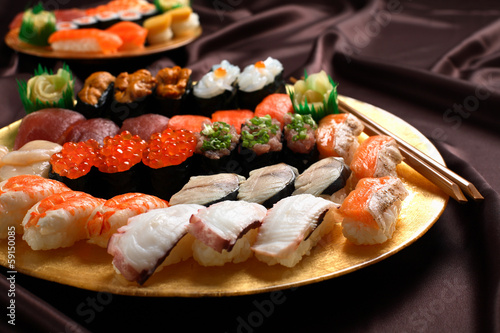 Set of sushi and rolls with a salmon